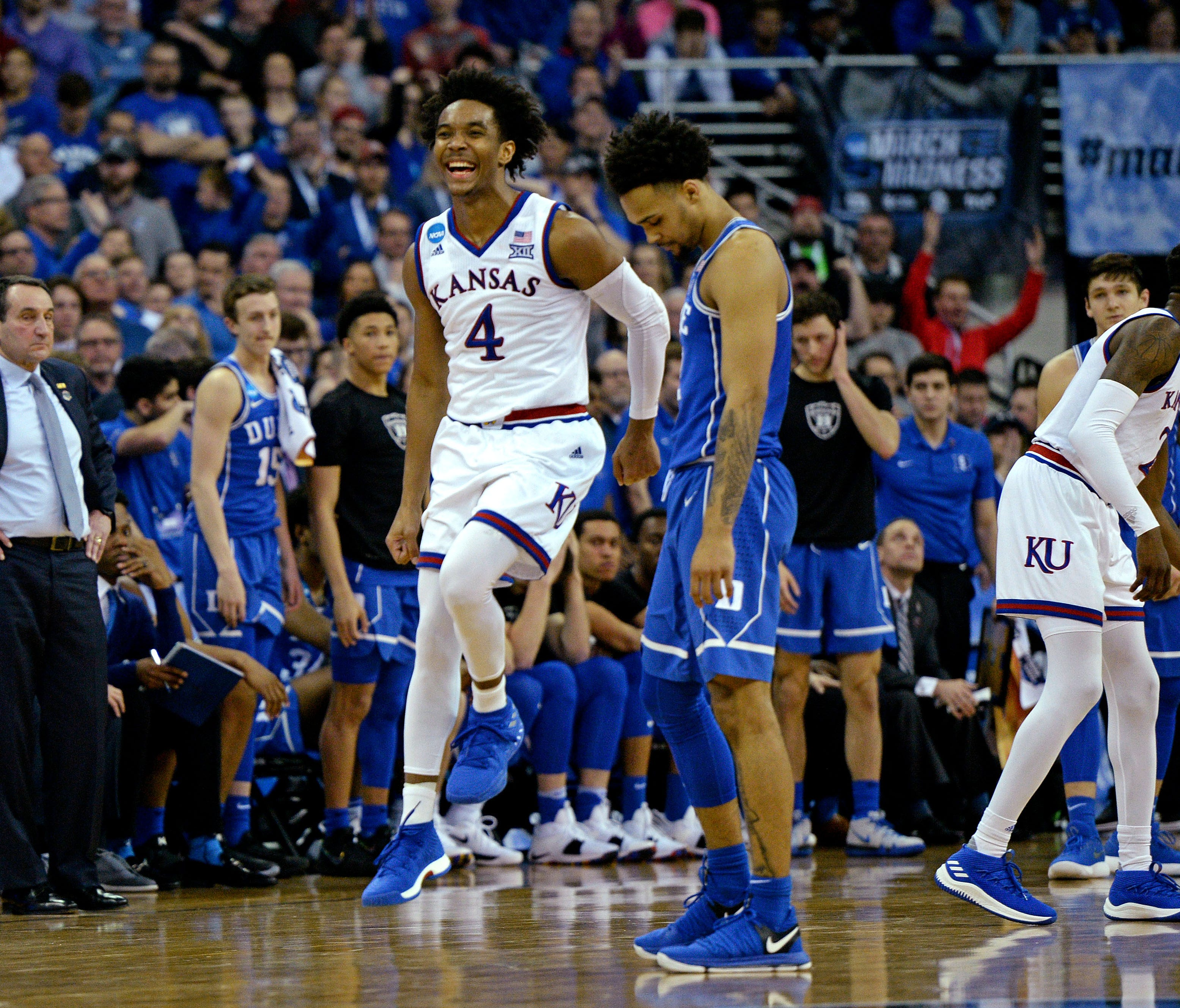 Kanasa guard Devonte' Graham celebrates after the Jayhawks beat Duke in the championship game of the Midwest regional of the 2018 NCAA tournament at CenturyLink Center.