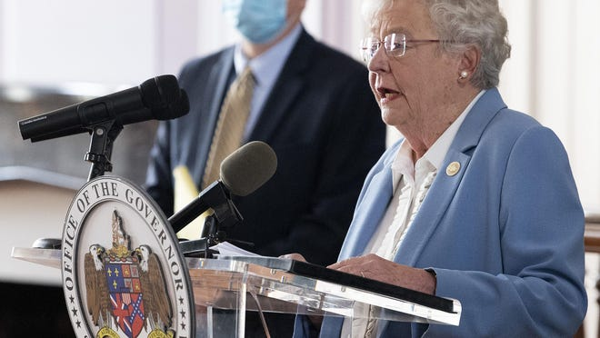 Gov. Kay Ivey and State Health Officer Dr. Scott Harris ask citizens to continue wearing masks and use social distancing during a coronavirus update in the state capitol building in Montgomery, Ala., in this June 29, 2020, photo.