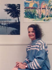 Martha Kiel with two of her works for a 1988 Artists