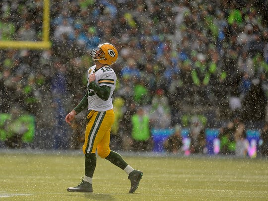 Green Bay Packers quarterback Aaron Rodgers reacts after throwing an interception against the Seattle Seahawks during Sunday's NFC Championship game at CenturyLink Field in Seattle.