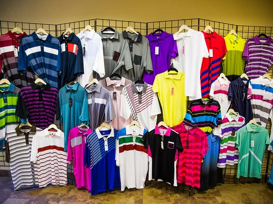 0428151130tk-Golf shirts are on display at    in Mesa, Thursday, April 30, 2015. The business is owned for former major league baseball pitcher Russ Ortiz.