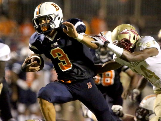 Blackman's Taeler Dowdy (3) runs the ball in for a