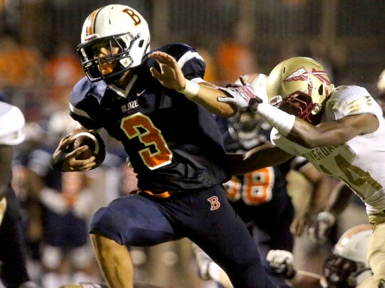 Blackman's Taeler Dowdy (3) runs the ball in for a touchdown in the second half as Riverdale's Preston Barge (14) tries to tackle Dowdy at the game at Blackman, on Friday Sept. 4, 2015.