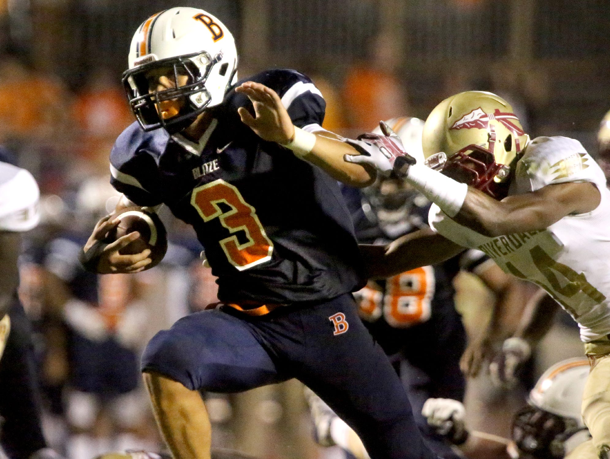 Blackman's Taeler Dowdy (3) runs the ball in for a touchdown in the second half as Riverdale's Preston Barge (14) tries to tackle Dowdy at the game at Blackman Friday Sept. 4, 2015.