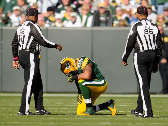 Green Bay Packers defensive end Jerel Worthy kneels on the field after getting injured in a 2012 game against the Jacksonville Jaguars at Lambeau Field. Worthy sustained a concussion and missed the following game.