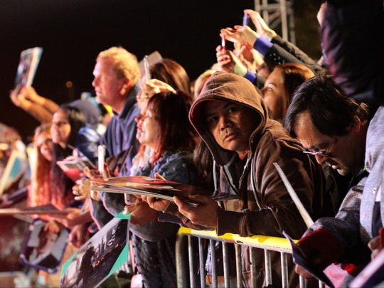 Fans wait for celebrities before the Palm Springs International Film Festival gala Saturday night, January 3, 2015 outside the Palm Springs Convention Center in Palm Springs, Calif.