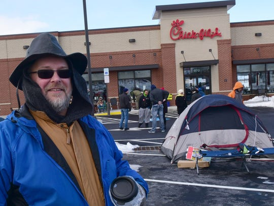 Christopher Nakoski is designated the first person in line for 52 free sandwich meals at the new Chick-fil-A restaurant on Norland Avenue, Chambersburg. The new restaurant opens for business Thursday. Local people are camping out at the business to be the first of 100 customers to receive the free meals.