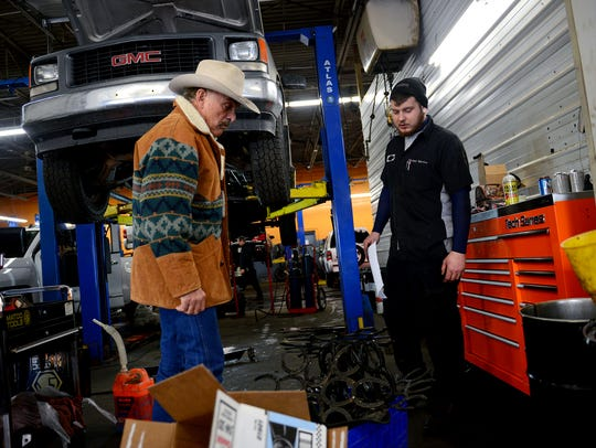 Terry Hanks talks with an auto technician at the Sundance