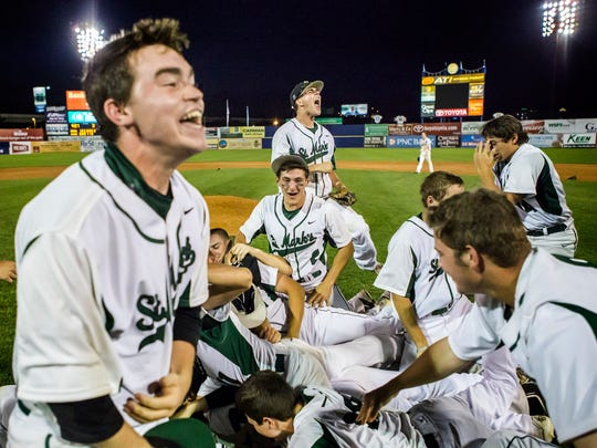 St. Mark's celebrate after a 5-4 comeback win over Caravel in the DIAA Baseball State Championship game at Frawley Stadium in Wilmington on Tuesday evening.