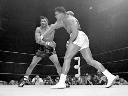 In this Nov. 22, 1965, file photo, world champion Muhammad