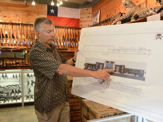 Ed Swadish, owner of Huron Valley Guns, shows off plans