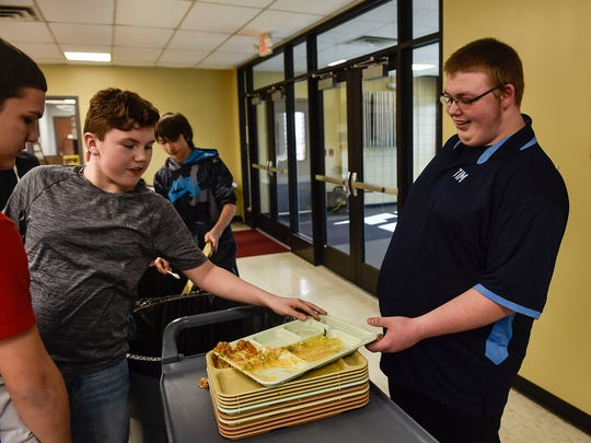 Tim Stewart, right, works in the Ridgedale cafeteria as part of his involvement in the school district's career-based intervention program.