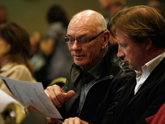 John Wessman, left, and Michael Braun, senior vice president of Wessman Development, study a design for the Desert Fashion Plaza at the Community Workshop #3 on February 9, 2011, at the Palm Springs Convention Center.