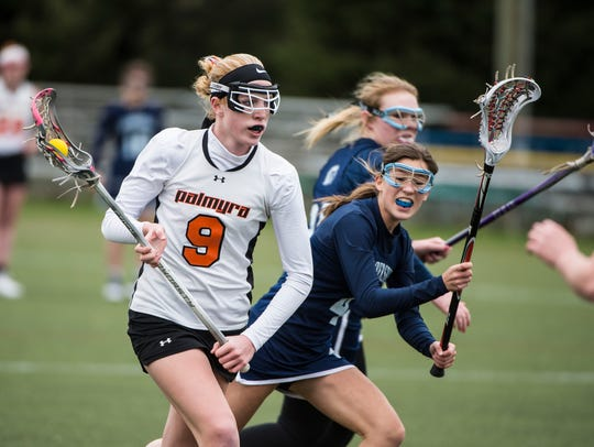 Palmyra's Nikki Bowman looks for open space as she