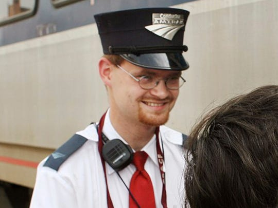 This Aug. 21, 2007, file photo shows Amtrak assistant conductor Brandon Bostian outside a train at the Amtrak station in St. Louis.