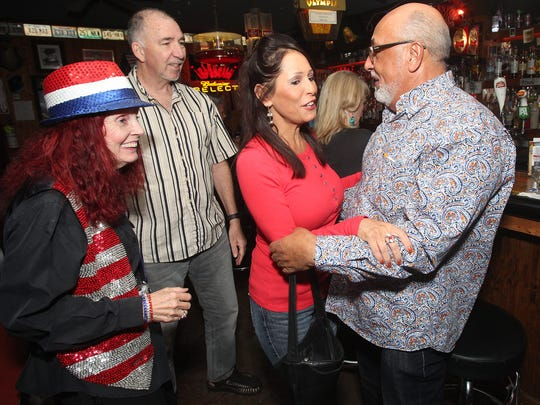 At far right, Palm Springs city council candidate Glenn Flood is greeted by his supporter Nubia McGraw at the Famous Palm Canyon Roadhouse on November 7, 2017.