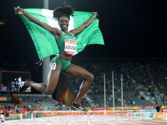 Nigeria's Oluwatobiloba Amusan celebrates after winning the women's 100m hurdles final at Carrara Stadium during the 2018 Commonwealth Games on the Gold Coast, Australia, Friday, April 13, 2018. (AP Photo/Mark Schiefelbein)