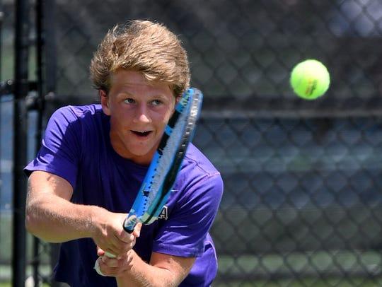 Christ Presbyterian's Nathan Irwin makes a return volley