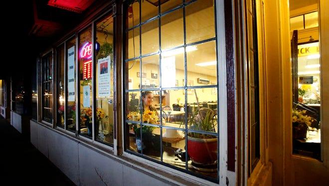 Main Street Cafe owner Angelina Guglielmo listens to her son, Jody Yorker, 5, as he tells stories Thursday inside the restaurant.