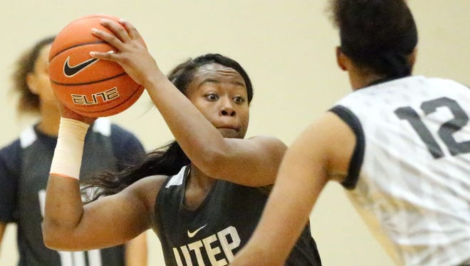 UTEP guard Roeshonda Patterson, 1, looks for an outlet during Friday's practice at the Foster-Stevens basketball complex.