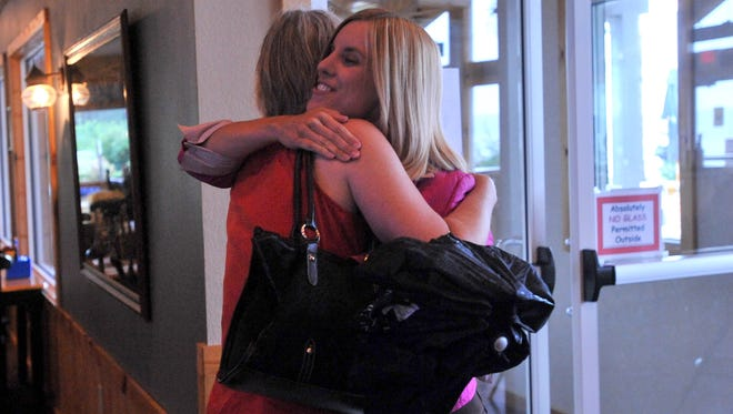 Sarah Gregory of Arpin, left and Jill Dillon from Rome give each other a hug, after meeting for the first time in 2010. The two became kidney donors to local people in need of a transplant.