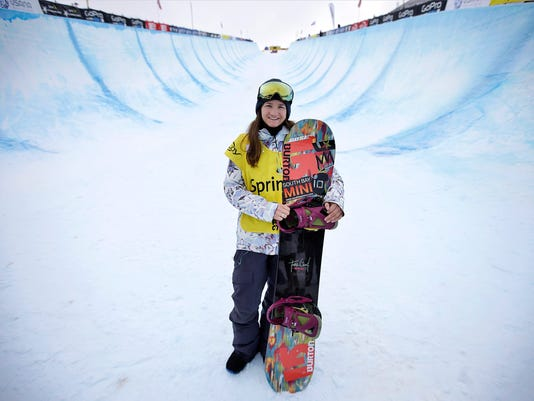 FILE - In this March 1, 2015, file photo, Kelly Clark, of the United States, poses for a photograph after competing in a World Cup halfpipe snowboard even, in Park City, Utah. Clark, with her gold medal and two bronze that she values every bit as much,  has nothing left to prove, this is the road she was willing to travel to make sure she leaves the competitive side of her sport on her terms, not on anyone else's. The 33-year-old snowboarding icon is willing to try for a fifth trip to the Olympic halfpipe. (AP Photo/Rick Bowmer, File)