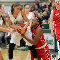 West High's Cailyn Morgan forces a jump ball as she tries to steal the ball from City High's Kenya Earl during their game at West High on Friday, Jan. 8, 2016.