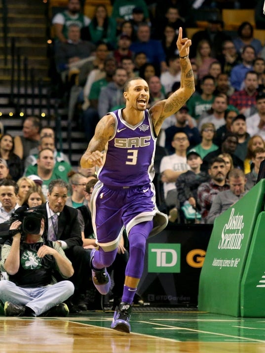 Sacramento Kings' George Hill (3) celebrates after making a basket during the first half of an NBA basketball game against the Boston Celtics in Boston, Wednesday, Nov. 1, 2017. (AP Photo/Mary Schwalm)