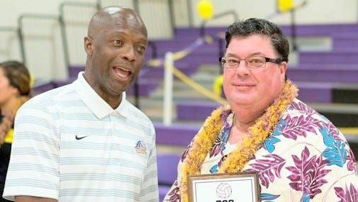 WNMU head volleyball coach Jim Callender celebrates his 700th win after beating Highlands on Saturday.
