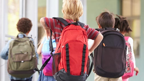 According to New Mexico Orthopaedics, Some kids may strain their backs from lugging around their schoolbooks. A survey of 1126 school children aged 12 to 18 published in the journal Spine found that chronic low back pain was associated with the weight of their school bags. A later study in the same journal found that carrying school bags on just one shoulder may also play a role in lower back pain.