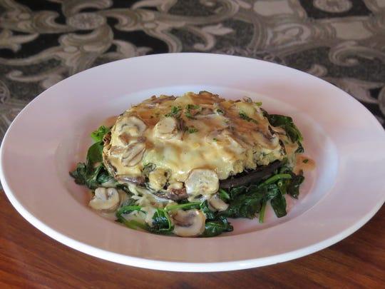Portobello Florentine, a dish that combines sauteed spinach with Gruyere, capellini and marsala cream sauce, is a La Dolce Vita Ristorante menu favorite of Michelle Kenney, the restaurant's executive chef and co-owner.