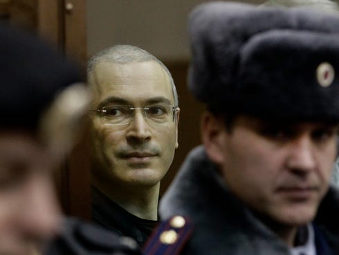 Mikhail Khodorkovsky seen on Dec. 30, 2010, from behind glass at a court room in Moscow.