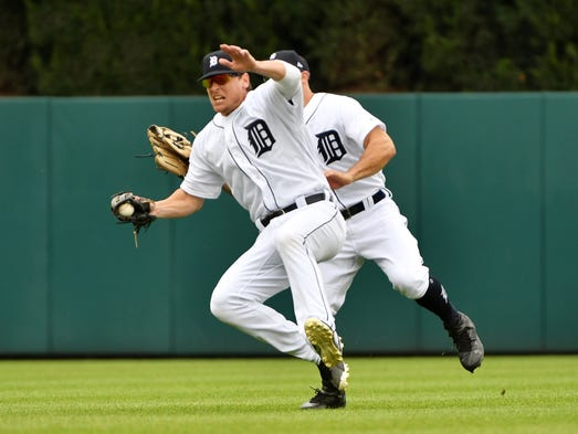 Tigers right fielder Jim Adduci catches a fly ball