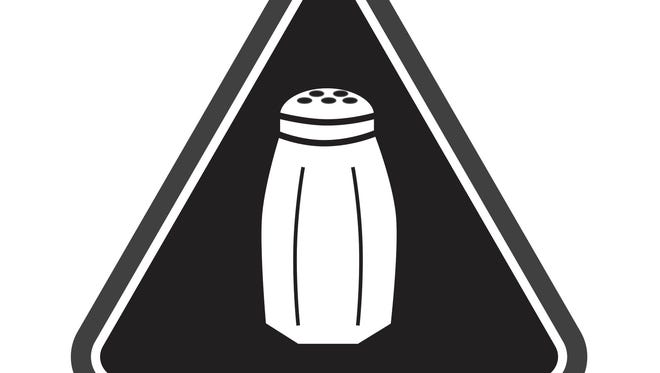 FILE- This undated image released by the New York City Health Department shows a graphic that warns NYC consumers of high salt content. An appeals court heard arguments Wednesday, Nov. 30, 2016, on New York City's first-of-its-kind rule that requires chain restaurants to use menu icons to warn patrons of salty foods. (Antonio D'Angelo/New York City Health Department via AP, File)