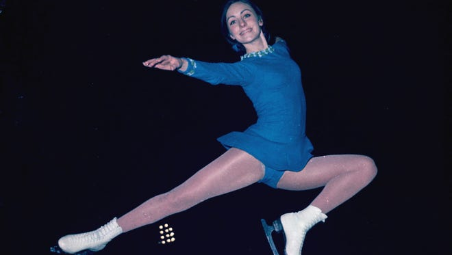 Peggy Fleming is shown in a high leap at the Olympic ice rink in Grenoble in preparation for her bid for a gold medal in the women's freestyle figure skating, February 9, 1968.  (AP Photo)