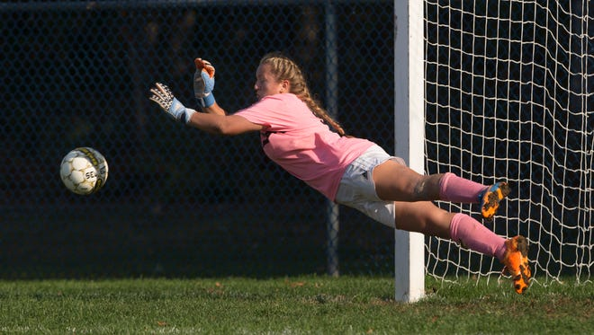 Lacey Goalie Jamie Kazenmayer knocks away a shot on goal.  St Rose Girls Soccer vs Lacey in Lacey Township, NJ on October 19, 2016.