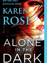 "The cover of ""Alone In the Dark"""
