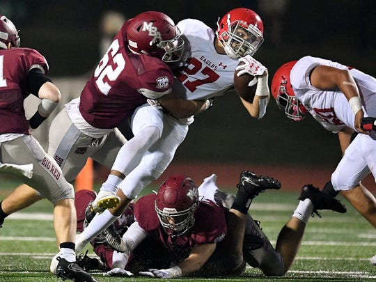 Brentwood Academy's Camron Johnson (27) is tackled by MBA's Rhys Rutherford (62) during the second half at Montgomery Bell Academy in Nashville, Tenn., Friday, Oct. 20, 2017.