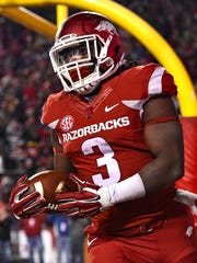 Arkansas running back Alex Collins (3) reacts after scoring a second-half touchdown that put the Razorbacks ahead 17-0 in their victory over LSU Saturday night that snapped a 17-game losing streak in the SEC.