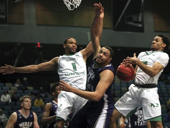 North Dakota guard Corey Baldwin (1) and guard Cortez