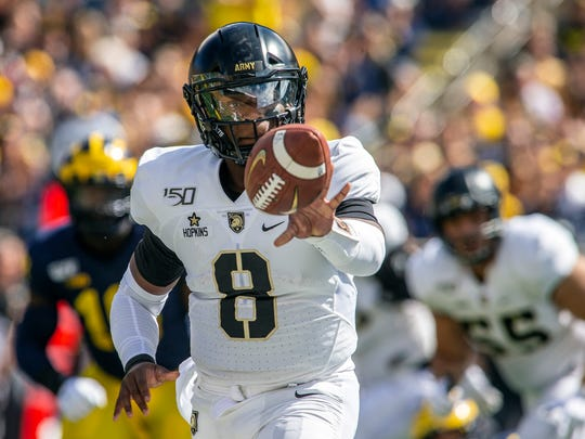 Army quarterback Kelvin Hopkins Jr. (8) flicks the ball in the first quarter of an NCAA football game against Michigan in Ann Arbor, Mich., Saturday, Sept. 7, 2019. (AP Photo/Tony Ding)