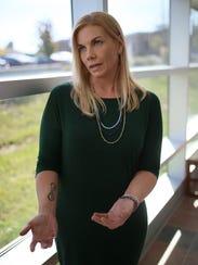FILE -- Nicole Beverly, a domestic violence survivor,