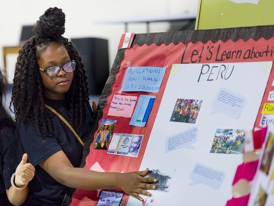 Zyah Jackson, age 13, discusses her Peru display at