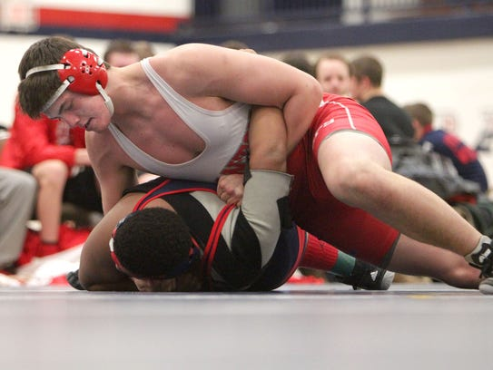 Subduing an opponent during a recent dual meet is Canton