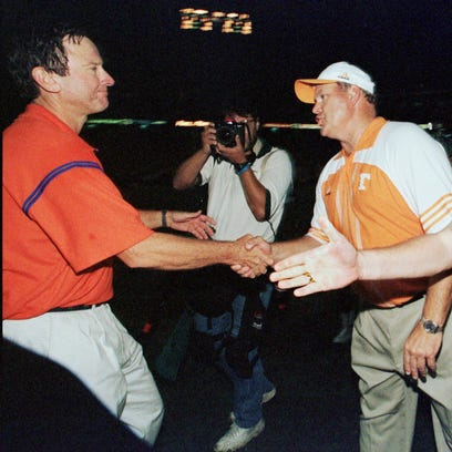 Florida head coach Steve Spurrier, left, shakes hands