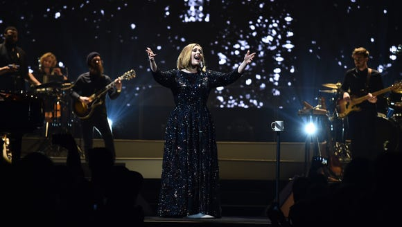Adele launches her world tour by helping a fan propose