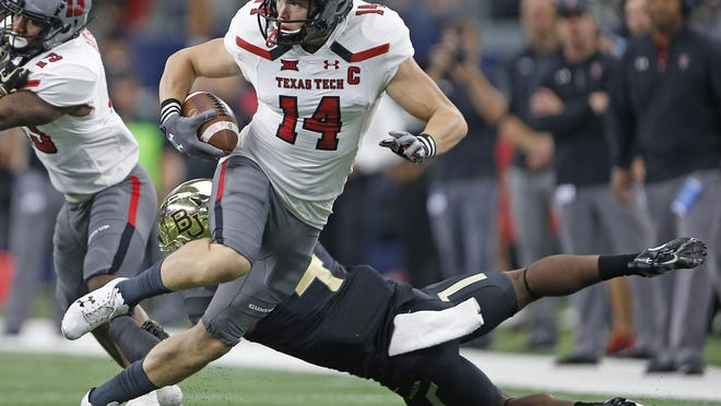 Former Texas Tech wide receiver Dylan Cantrell (14) signed a one-year contract with the Arizona Cardinals, the NFL team announced Monday. Cantrell is making a position switch to tight end.