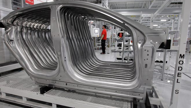 Tesla Model S frames are shown in the assembly area at the Tesla factory in Fremont, Calif., on June 22, 2012.