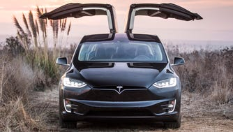 The upward opening, rear seat doors on the Tesla Model X have hurt its reliability ratings