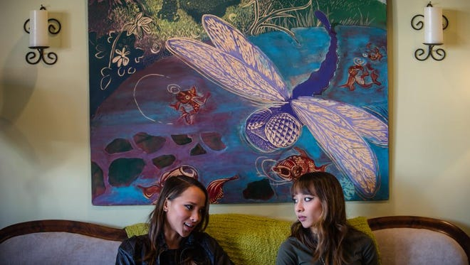 Sarina and Nalani Bolton, a twin sister duo from Flemington, talk about music on Jan. 6 at the Dragonfly Music & Coffee Cafe in Somerville.